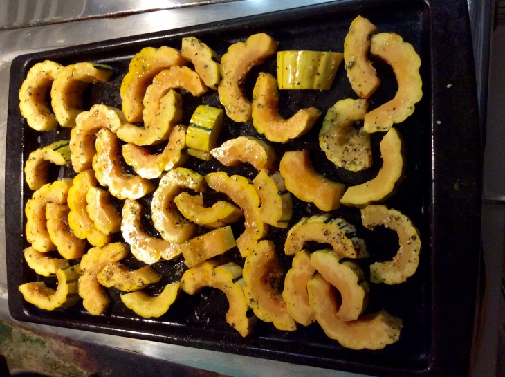 Delicata squash on a baking sheet