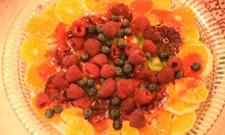 beautiful fruit salad with oranges, raspberries, kiwi and blueberries