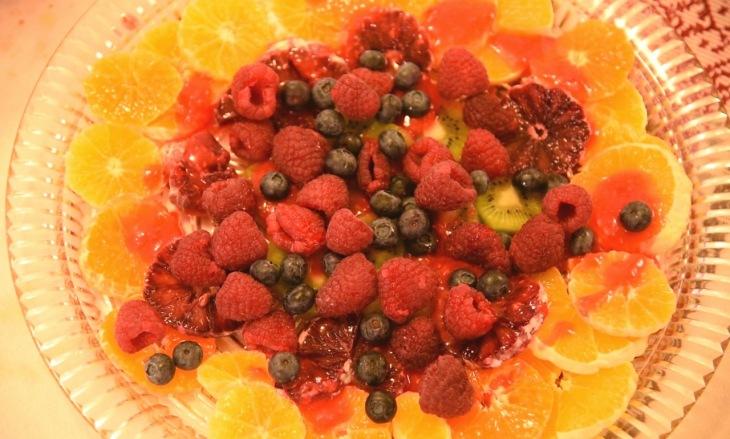 beautiful fruit salad with oranges, raspberries, kiwi and blueberries