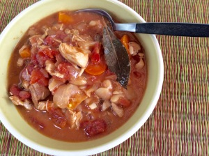Bowl of Chili with fresh chicken, white beans, carrots, tomatoes and other fresh ingredients