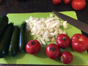 Onions, Zucchini and Tomatos in a pan