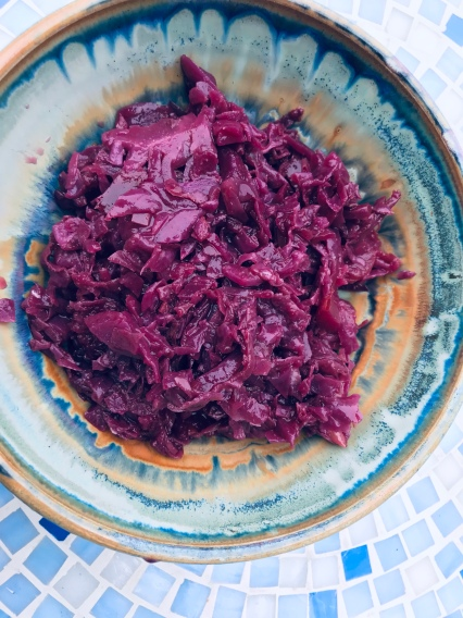 Bowl of Red Cabbage made with sugar and vinegar on a mosaic table