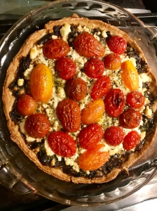 Baked tart of onions, tomatoes, and goat cheese won a pastry shell